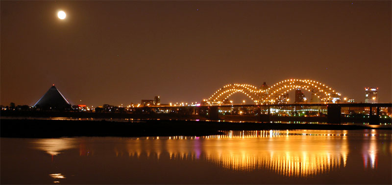 Memphis pyramid, looking from Arkansas. Moonrise over the Memphis pyramid,